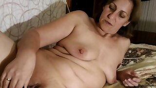Big stepmom uses a dildo on..